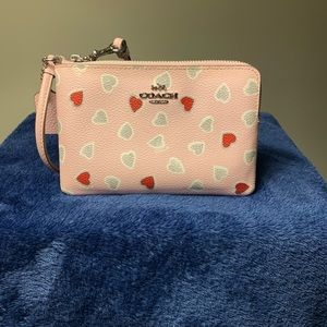 Coach Pink Wristlet with hearts